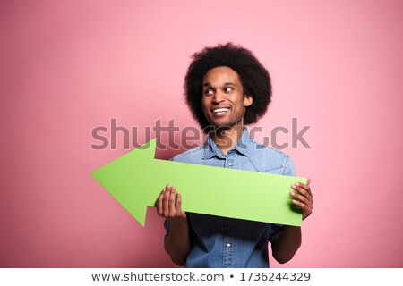 Man holding horizontal direction arrow sign. Stock photo © lichtmeister