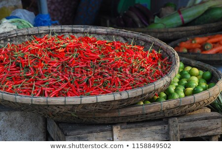 Limes in the wicker basket on the Vietnamese market Stock photo © galitskaya