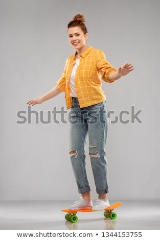 赤 十代の少女 ライディング 短い スケート レジャー ストックフォト © dolgachov