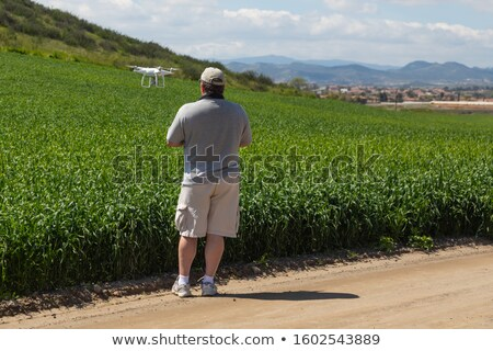 Pilot Flying Unmanned Aircraft Drone Gathering Data Over Country Stock photo © feverpitch