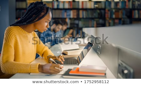student writing to notebook at exam or lecture Stock photo © dolgachov