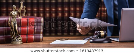 Lawyer Holding Documents Near Mallet And Laptop Stock photo © AndreyPopov