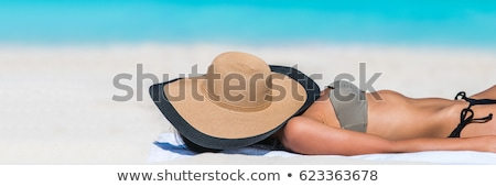 Stock photo: Banner of woman tanning on the beach by the sea in her vacation