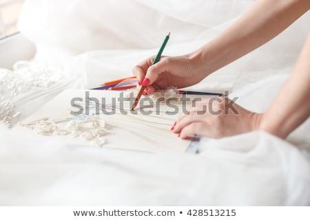Creating wedding gown with designer Stock photo © pressmaster