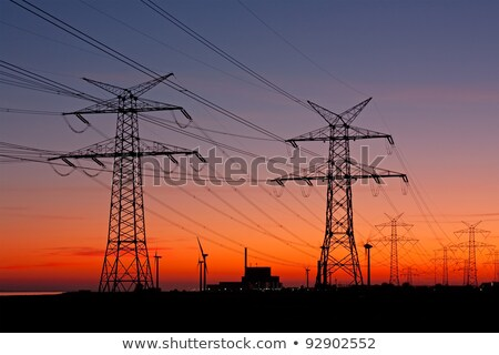 Wind turbines and an overhead power line Stock photo © elxeneize