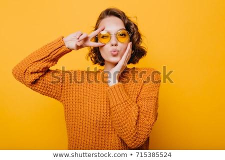 Trendi fiatal nő áll citromsárga fal forró Stock fotó © boggy