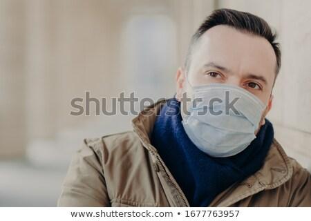 Ziek man masker besmettelijk ziekte nadenkend Stockfoto © vkstudio