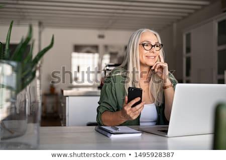 シニア 女性 ラップトップを使用して イヤホン リラックス ソファ ストックフォト © ayelet_keshet