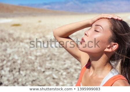 Heat stroke tired dehydrated girl under the desert sun hot temperature summer weather danger. Asian  Stock photo © Maridav