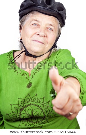 Confident old senior cyclist woman Stock photo © dundanim