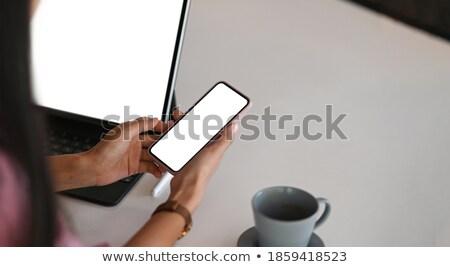Zárt lövés nő kéz tart mobiltelefon Stock fotó © dacasdo