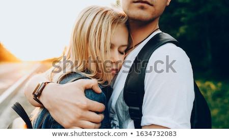 Young woman kissing her boyfriend  stock photo © dacasdo