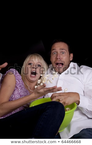 a couple watching a scary movie and it scared them so much that stock photo © hasloo