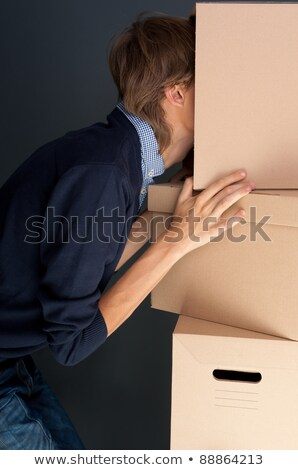 Portrait of anonymous young man with his head inside box Stock photo © HASLOO