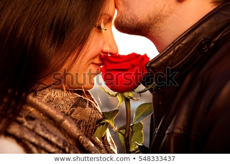 Stock photo: gentle kiss with flowers