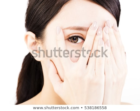 cheerful asian young woman cover face with hands stock photo © ampyang