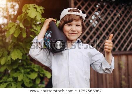 Child enjoying portable music Stock photo © lovleah