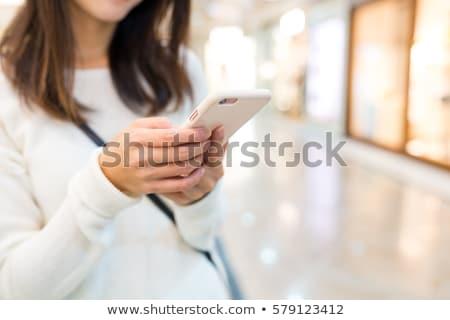 üzletasszony mobiltelefon mutat okostelefon szexi boldog Stock fotó © dash
