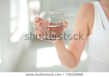 Woman and Glass of Ice Stock photo © piedmontphoto