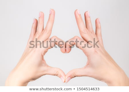woman making a hearth symbol with her hands Stock photo © photography33