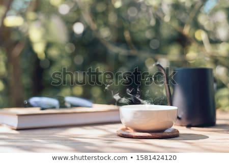 Bağbozumu çay fincanı görmek sıcak çay Stok fotoğraf © klsbear