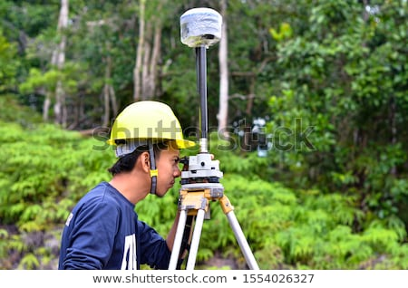Surveyor setting-up equipment Stock photo © photography33