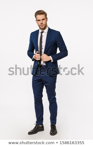 Handsome Business Man in Suit with Cheeky Smile Stock photo © scheriton