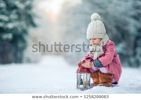 little girl waiting for santa on christmas eve stock photo © balasoiu