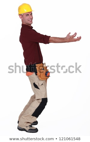 Tradesman carrying an invisible object Stock photo © photography33