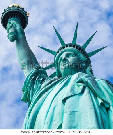 Liberté silhouette statue ville coucher du soleil Photo stock © HectorSnchz