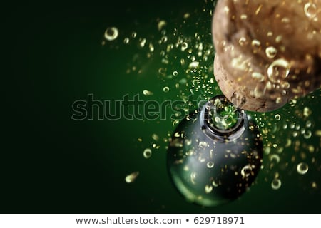 Champagne corks and spilled champagne stock photo © calvste