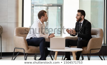 Banqueiro sorrir homem azul relaxar executivo Foto stock © photography33