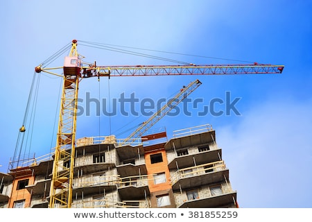 Crane lifting building materials Stock photo © photography33