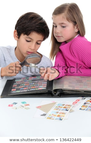 two kids collecting stamps stock photo © photography33