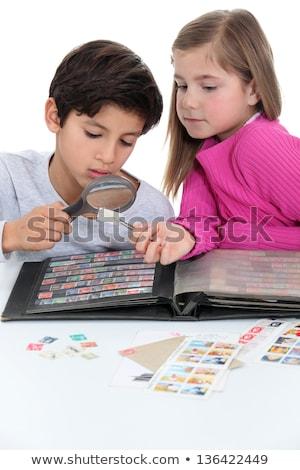Dwa dzieci znaczków dziewczyna szkła Zdjęcia stock © photography33