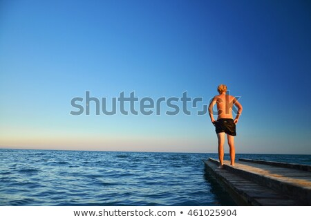 Montage homme pier eau printemps heureux Photo stock © photography33