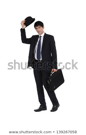 smart young businessman with suitcase greeting by removing bowler Stock photo © photography33