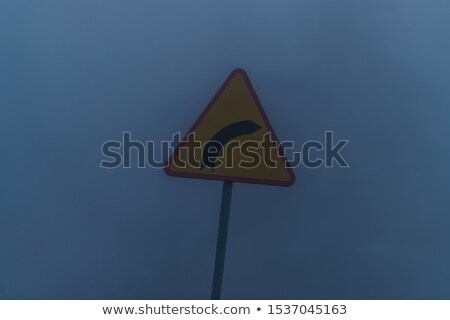 Traffic sign Turn Right to the mist Stock photo © cgsniper