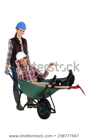 female builder carrying his colleague in a wheelbarrow Stock photo © photography33