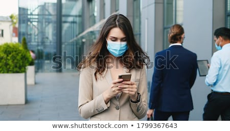 Businesswoman tapping a cellphone stock photo © photography33