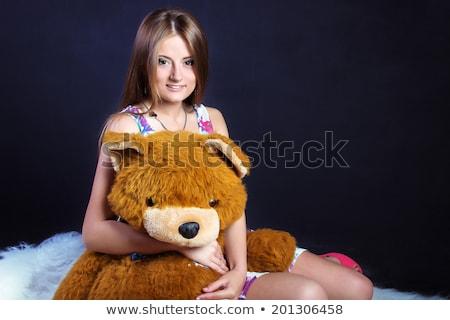 cheerful young blonde woman lying on soft carpet posing stock photo © pawelsierakowski