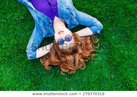 women lie down on grass Stock photo © get4net
