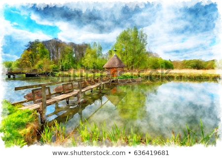 Thatched Fisherman's Hut & Eel traps Stock photo © flotsom