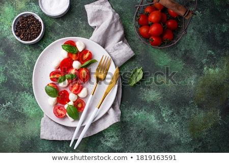 Mozzarella domates salata beyaz plaka ahşap masa Stok fotoğraf © doupix
