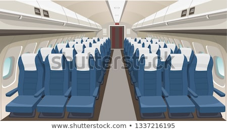 airplane with passengers interior view stock photo © lunamarina
