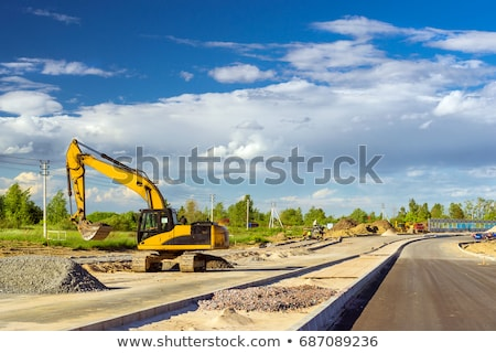 heavy bulldozer and excavator on road construction Stock photo © goce