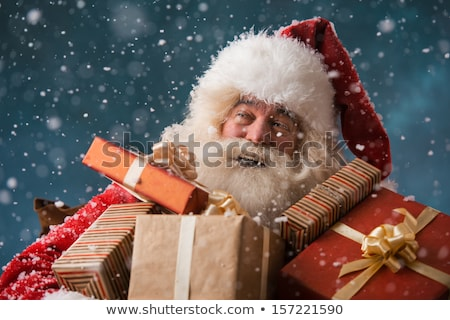 Santa Claus walking on the snow with his sack of gifts Stock photo © HASLOO