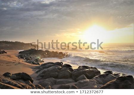 Gün batımı kayalar deniz gökyüzü güneş yaz Stok fotoğraf © gllphotography