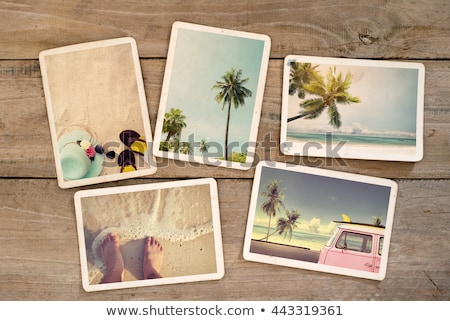 Stock fotó: Travel Photo Frames On Wooden Texture