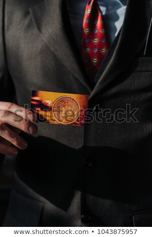 businessman holding card with title we are accepting bitcoins stock photo © stevanovicigor